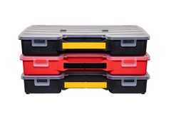 Equipment of craftsman. Three professional plastic storage boxes for screws, bolts, dowels and some other components isolated on a royalty free stock photos