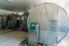 Equipment at dairy plant. Dairy factory tanks for milk chilling royalty free stock images