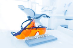 Equipment and dental instruments in dentist's office. Googles Stock Images