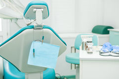 Equipment and dental instruments in dentist`s office. Tools close-up. Dentistry. Dental concept background. Selective focus. Spac Royalty Free Stock Photo