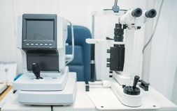 Equipment for diagnostic of vision, eyesight test. Equipment for diagnostic of vision, instrument for eyesight test in oculist cabinet, nobody. Optician office royalty free stock photography