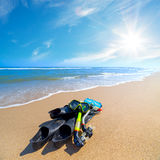 Equipment for Diving on the sea beach with blue sky and sun Stock Photos