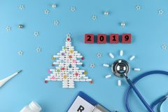 Equipment of doctor in Christmas and new years 2019 theme. royalty free stock photo