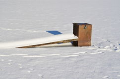 Equipment for draining water from the lakes frozen in ice, south Royalty Free Stock Photos