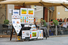 Equipment and drawings street artist outside restaurant in Flore Royalty Free Stock Photo