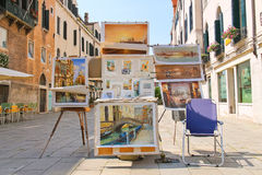 Equipment and drawings street artist in Venice, Italy. VENICE, ITALY - MAY 06, 2014: Equipment and drawings street artist in Venice, Italy Royalty Free Stock Photos