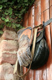 Equipment the falconer. The leather bag and the glove - hanging on the gate in the Château de Kintzheim (The Eagles' Nest royalty free stock photo