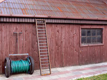 Equipment on the farm. Wooden wall and  leaning ladder Royalty Free Stock Images