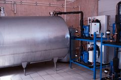 Equipment on the farm for processing, storing and cooling cow`s milk, producing cow`s milk, storage tank for cow milk, charge stock image