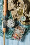 Equipment for fishing with compass, backpack and rods Royalty Free Stock Photography