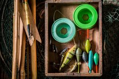 Equipment for fishing with fishing rod and lures. On dark background Stock Photos