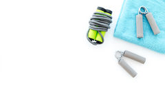 Equipment for fitness. Jump rope and expander on white background top view copyspace Stock Image
