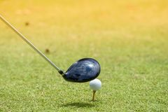 The golf ball is hit. Equipment for golf. On the green lawn Ready for play royalty free stock photos