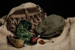 Hunting Gear Spread Out On Old Cloth With A Black Background Equipment For