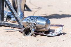 Equipment knight - the participant in the knight festival - shield, sword, helmet and glove lie on the ground  near the lists. Equipment knight - the participant Royalty Free Stock Images