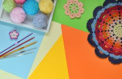 Equipment for knitting and crochet hook, rainbow cotton yarn, ball of threads, wool, knitted elements, napkin . Granny square. stock images