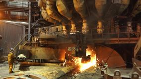 Equipment and machines at the metallurgical plant. Heavy industry. Stationary machines opening