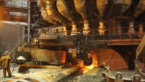 Equipment and machines at the metallurgical plant. Heavy industry. Stationary machines opening stock photo