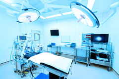 Equipment and medical devices in modern operating room. Take with art lighting and blue filter Royalty Free Stock Photos