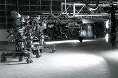 Equipment of a modern television studio. Videocameras and lighting devices of a modern television studio Stock Images