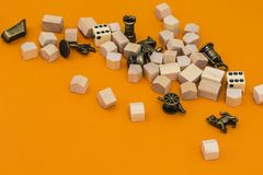 Equipment for monopoly game. On orange background royalty free stock photo