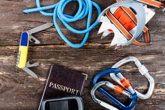Equipment for mountaineering and hiking on wooden background. Royalty Free Stock Photos