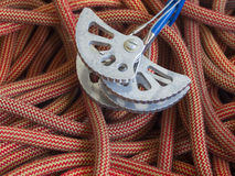 Equipment for mountaineering lie on the orange rope. Royalty Free Stock Image
