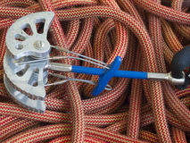 Equipment for mountaineering lie on the orange rope. Royalty Free Stock Images