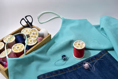 Equipment needlework. Sewing machine blue lady singlet,Jeans and equipment Royalty Free Stock Photo