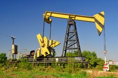 Oil rig in the field. Equipment for oil production in the field Royalty Free Stock Photos