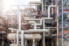 The equipment of oil refining, Detail of oil pipeline with valves in large oil refinery, Industrial zone. Royalty Free Stock Images