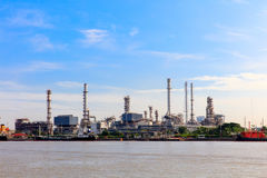 The equipment of oil refining, Detail of oil pipeline with valves in large oil refinery, Industrial zone. Royalty Free Stock Photos
