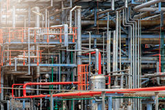 The equipment of oil refining, Detail of oil pipeline with valves in large oil refinery, Industrial zone. The equipment of oil refining, Industrial zone stock images