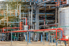 The equipment of oil refining, Detail of oil pipeline with valves in large oil refinery, Industrial zone. The equipment of oil refining, Industrial zone royalty free stock photos