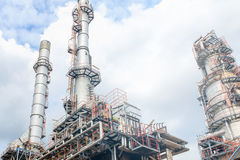 The equipment of oil refining, Detail of oil pipeline with valves in large oil refinery, Industrial zone. The equipment of oil refining, Industrial zone royalty free stock image