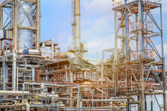 The equipment of oil refining, Detail of oil pipeline with valves in large oil refinery, Industrial zone. The equipment of oil refining, Industrial zone stock photo