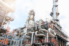 The equipment of oil refining, Detail of oil pipeline with valves in large oil refinery, Industrial zone. The equipment of oil refining, Industrial zone royalty free stock images