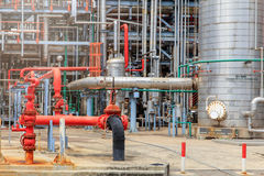 The equipment of oil refining, Detail of oil pipeline with valves in large oil refinery, Industrial zone. Royalty Free Stock Photo