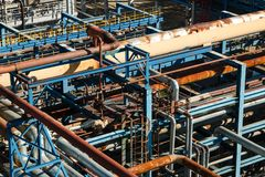 The equipment of oil refining. Industrial zone,The equipment of oil refining,Close-up of industrial pipelines of an oil-refinery plant,Detail of oil pipeline royalty free stock images