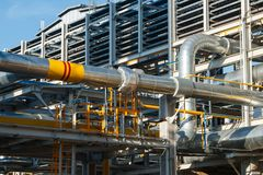 The equipment of oil refining. Industrial zone,The equipment of oil refining,Close-up of industrial pipelines of an oil-refinery plant,Detail of oil pipeline stock image