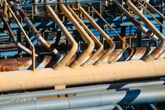 The equipment of oil refining. Industrial zone,The equipment of oil refining,Close-up of industrial pipelines of an oil-refinery plant,Detail of oil pipeline royalty free stock photography