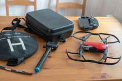 Equipment for photo and video shooting. Go pro, drone, drone box, telephone, remote control, helipad on the table. royalty free stock photography