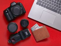 Equipment photographer, laptop, purse with dollars on a green b stock photography