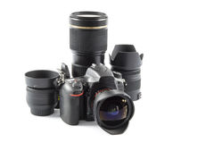 Equipment for the photographer. Professional DSLR Camera and various lenses Royalty Free Stock Photo