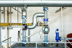 Equipment and piping industrial gas boiler room Stock Photos
