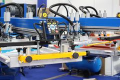 Equipment for printing on textiles. Automatic printing press. Moscow, RF, 03.20.2019: Equipment for printing on textiles. Automatic printing press. Printing royalty free stock image