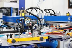Equipment for printing on textiles. Automatic printing press. Moscow, RF, 03.20.2019: Equipment for printing on textiles. Automatic printing press. Printing royalty free stock images