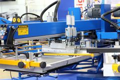 Equipment for printing on textiles. Automatic printing press stock photos