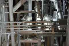 Equipment for production of beer in factory shops Royalty Free Stock Photo