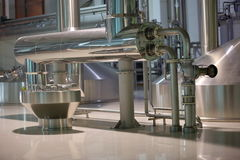 Equipment for production of beer in factory shops Royalty Free Stock Photography